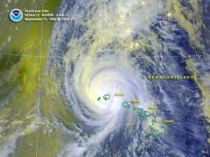 Iniki passing over the island of Kauai.  Image courtesy of NOAA.